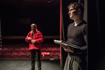 Actor Holding Script During Theatrical Rehearsa
