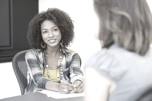 African American woman taking an interview of a woman