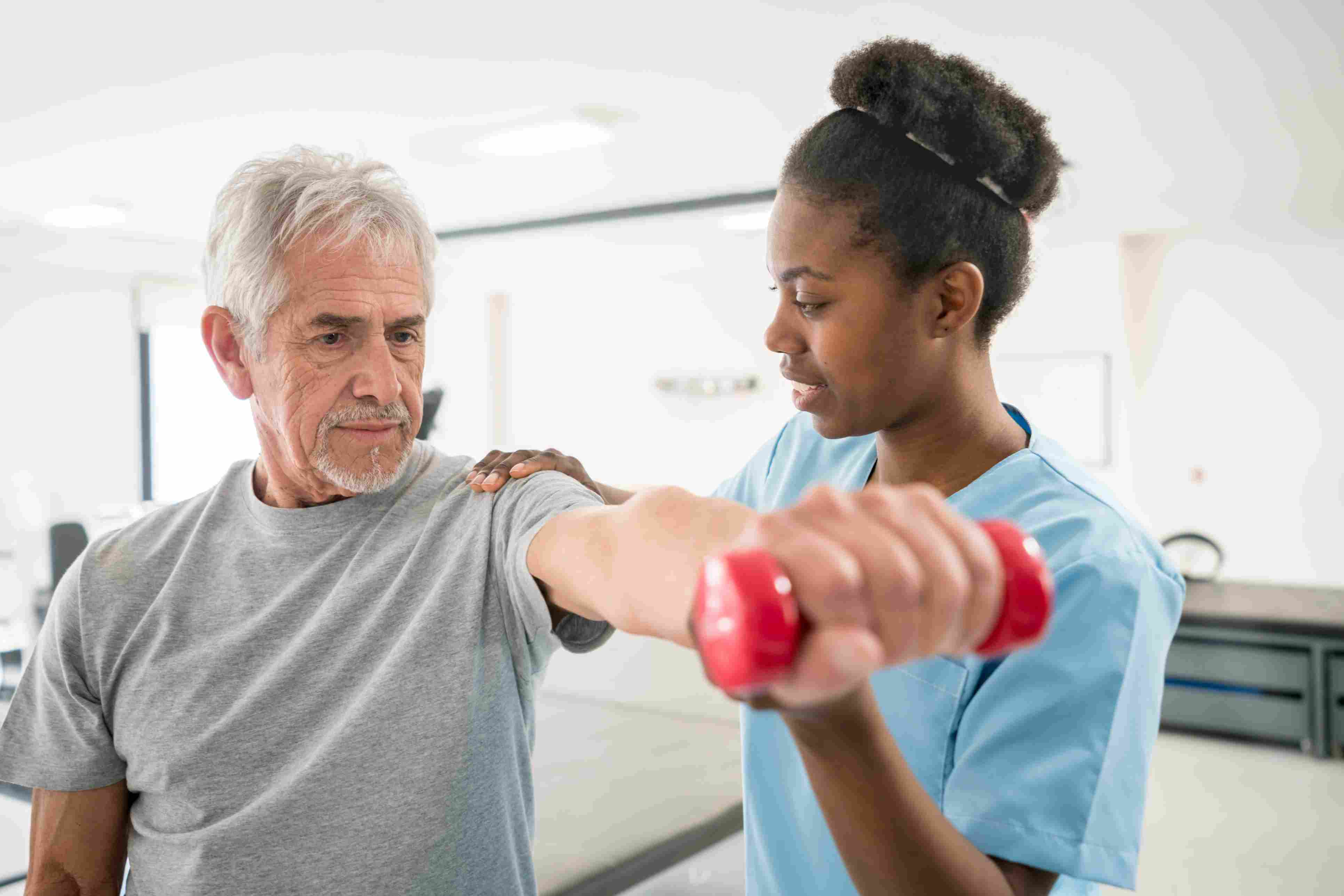Physical therapist assistant with patient