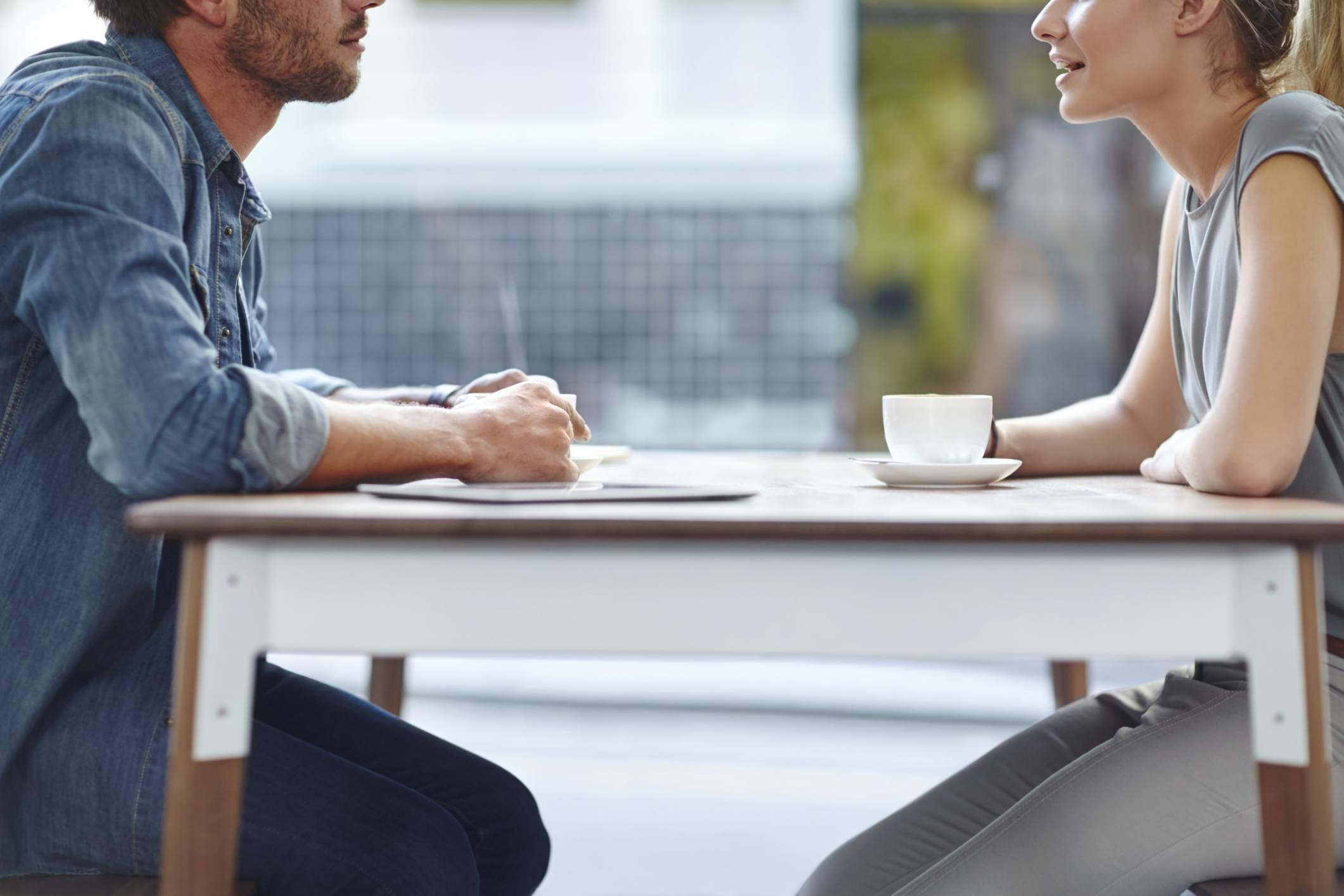 Two people in coffee shop networking about a job