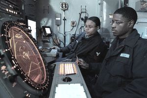 Military air traffic controllers at their workstation.