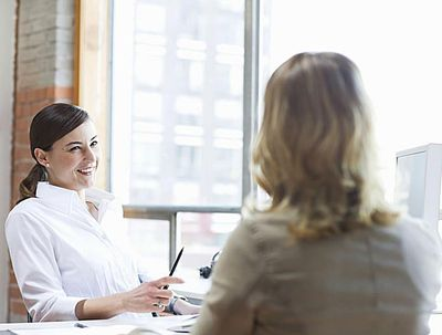 Business woman interviewing a woman with a smile