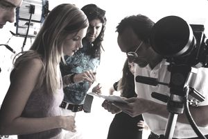 Model and photographer reviewing a modeling voucher on a shoot.