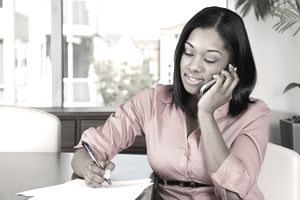 A woman speaking on the phone.