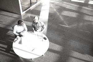 Businessmen meeting in an open plan office