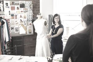 A fashion designer working in their studio