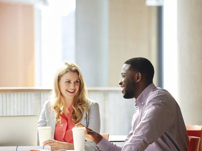 employees take coffee break together in a culturally diverse workplace
