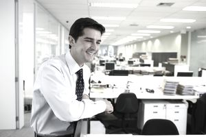 young business man leaning on cubicle