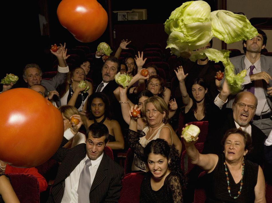 Audience throwing vegetables at performers