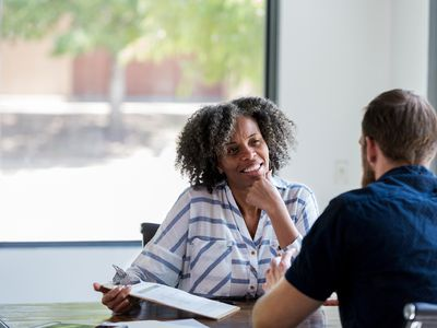 A business woman is conducting a behavioral interview with a candidate.