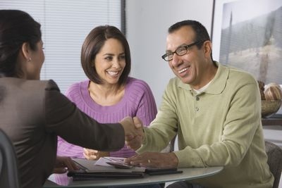 Man and woman interviewing a job candidate