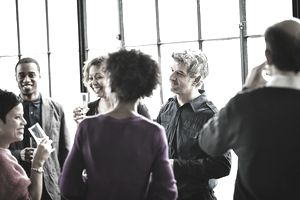 Group of people networking at an event