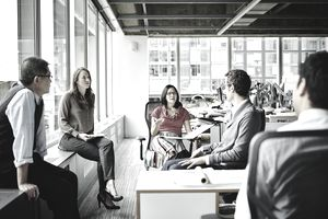co-workers conversing in an office space