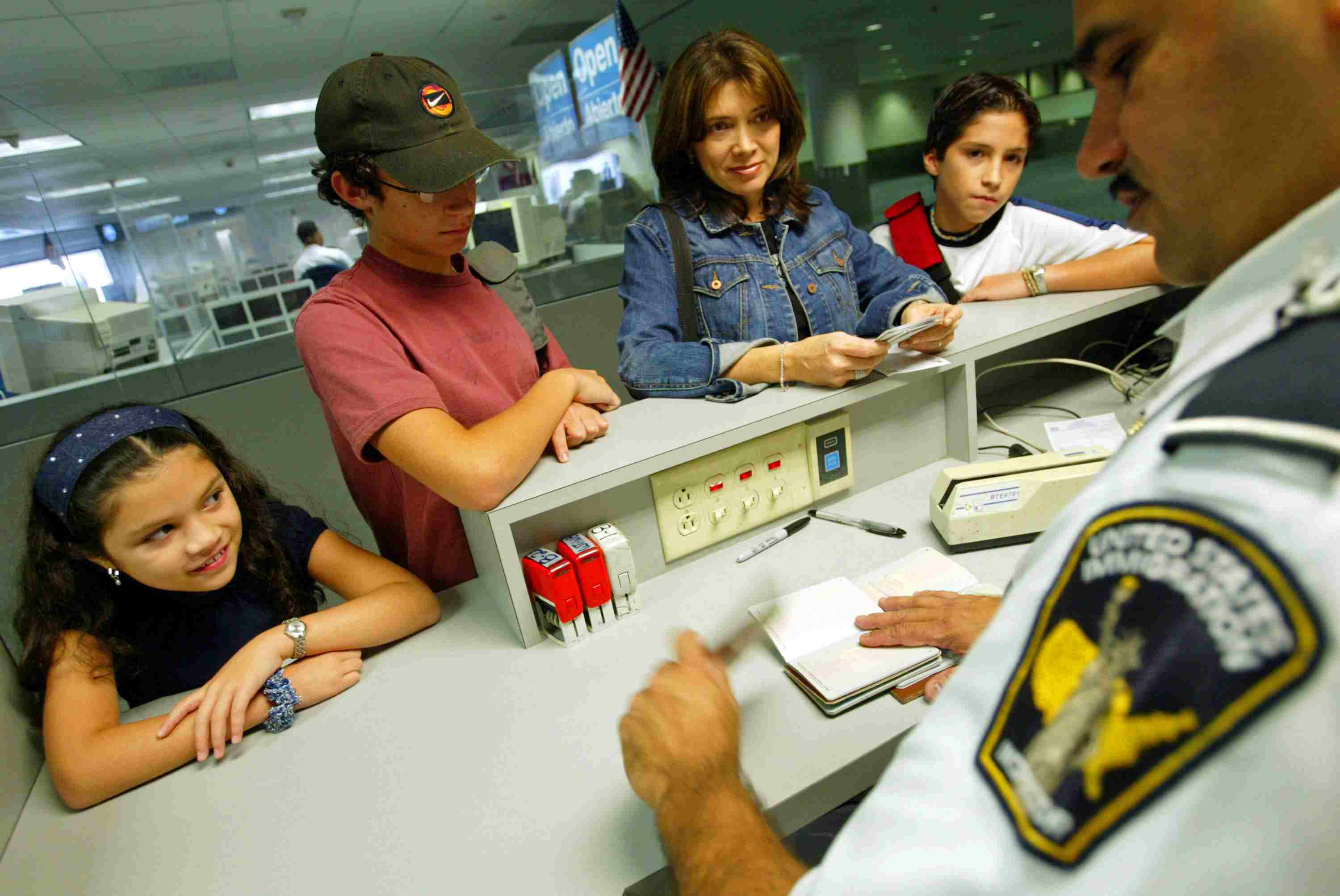 A family speaks with an immigration specialist
