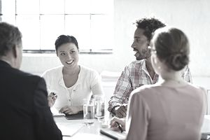 Two women and two men - coworkers in a meeting