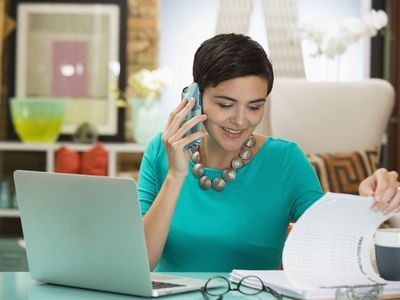 Busy woman working at an office desk