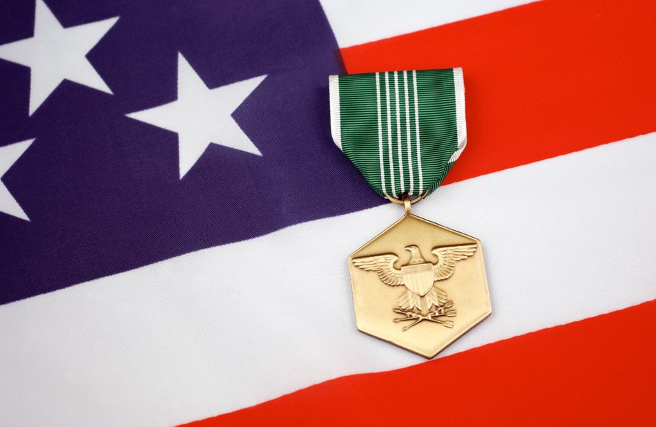 Army Commendation Medal laying on a US flag