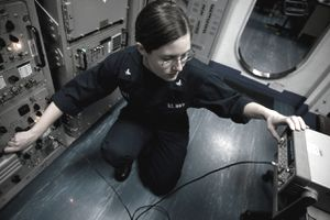 PACIFIC OCEAN (May 26, 2011) Electronics Technician 3rd Class Kelly Hall conducts maintenance on a receiver-transmitter unit in an ultra high frequency radio room aboard the Nimitz-class aircraft carrier USS Carl Vinson (CVN 70). Carl Vinson and Carrier Air Wing (CVW) 17 are underway in the U.S. 7th Fleet area of responsibility.