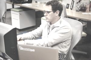 Man working on computer at office desk