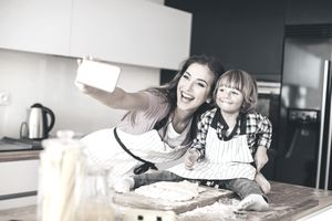 Woman and child taking a selfie in the kitchen