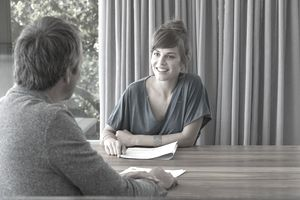 Young woman in meeting with advisor in an office