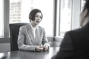 Businesswoman talking to her partner at a meeting