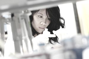 A young woman working in a lab.