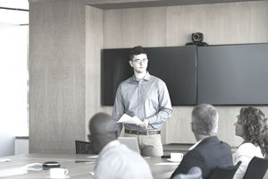 Man giving presentation in board room