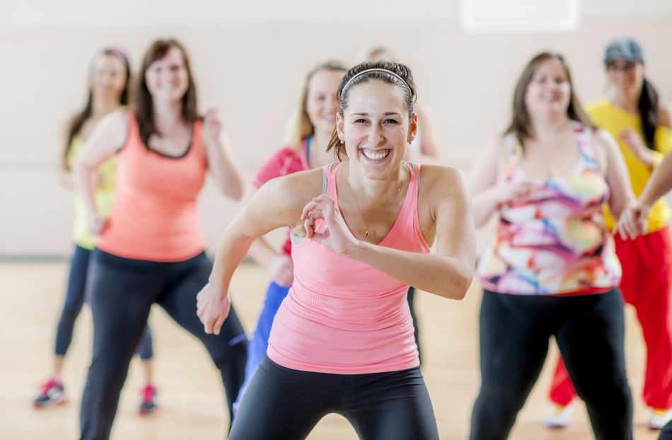 Woman in Dance Fitness Class Laughing