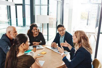 Workplace team members putting discuss plans for a project.