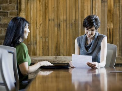 Interviewer reviewing resume with key skills