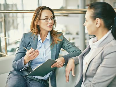 Woman interviewing for a job as an advertising agency traffic manager.