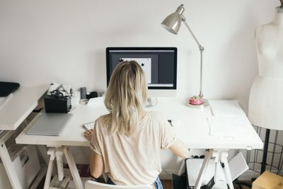 High angle view of female design professional using computer at home