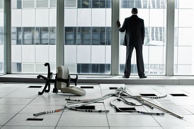 Businessman in abandoned office