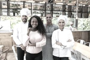 Business owner with her staff working at a restaurant