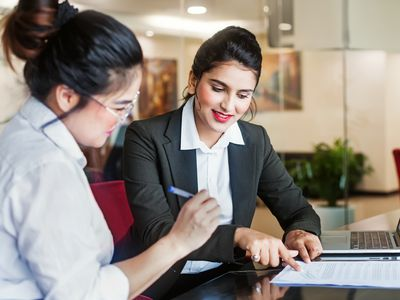 Saleswoman and client signing a contract