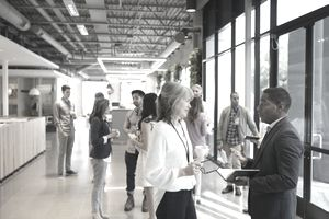 Business people networking in office lobby