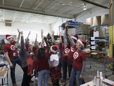 Celeebration traditions in the office can include volunteer work as well as celebrations.