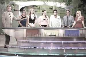 A photo of people competing on the TV game show Wheel of Fortune