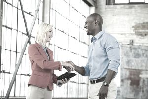 Salesperson closing a deal and shaking hands with a customer