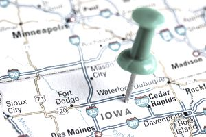 A map of Iowa with a push pin in place