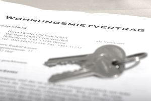 Two keys on an apartment contract