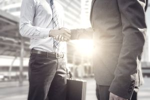 Success and Happiness concept, Businessman handshake at city outside office.