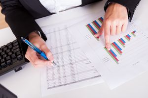 Woman working with bar graphs