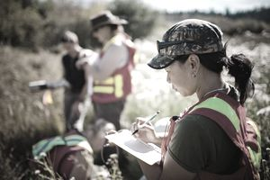 A geographer taking notes in the field.