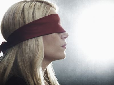 Businesswoman wearing a blindfold