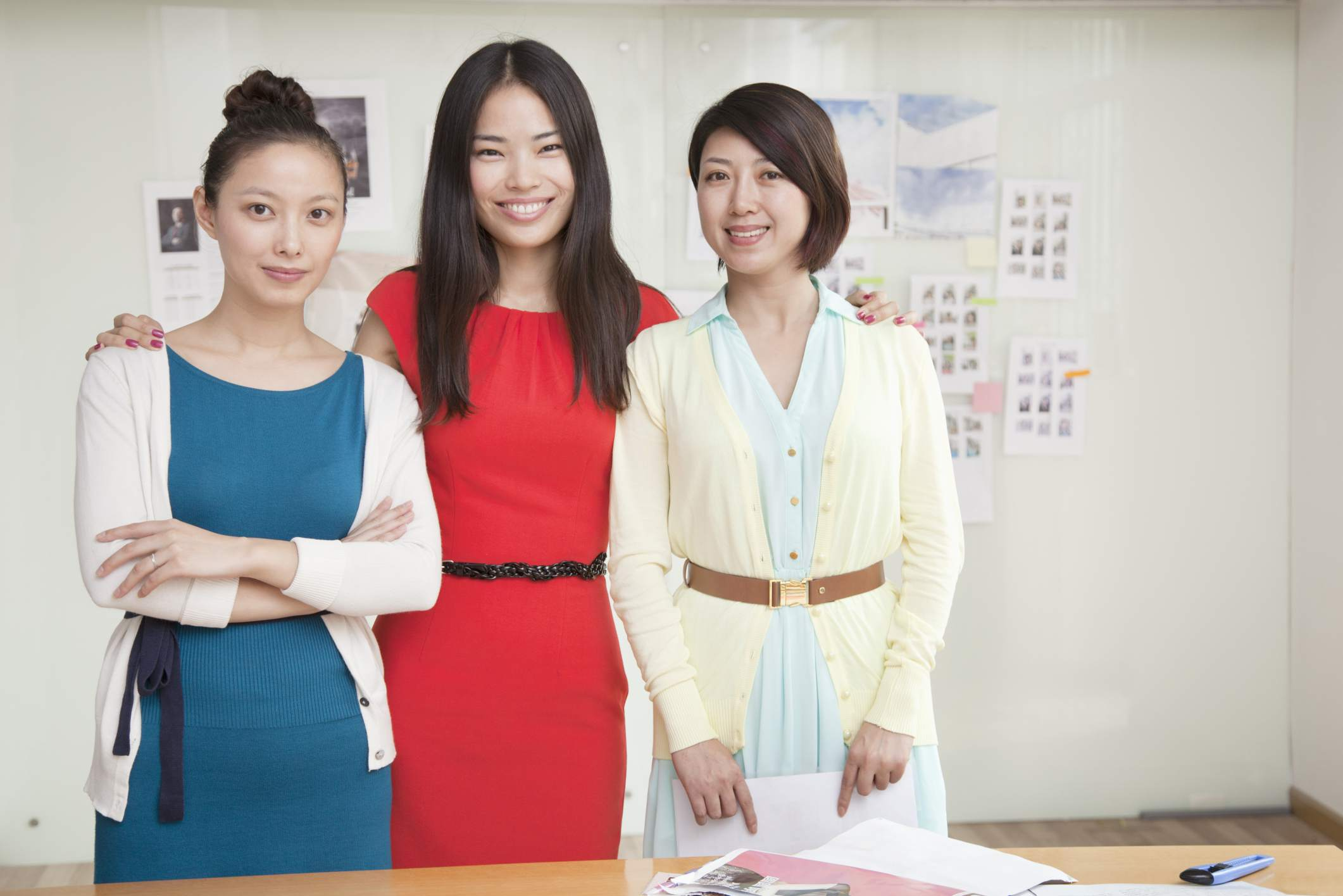 Three women in business casual clothes