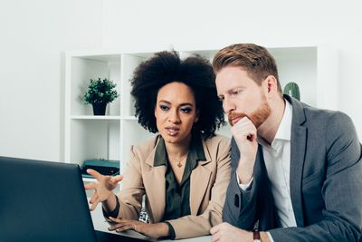 In a mentoring relationship, a more experienced employee shares knowledge with a colleague.