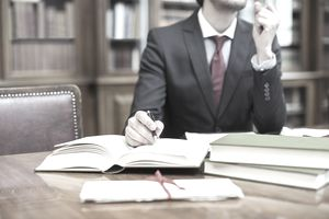 lawyer at desk with open books