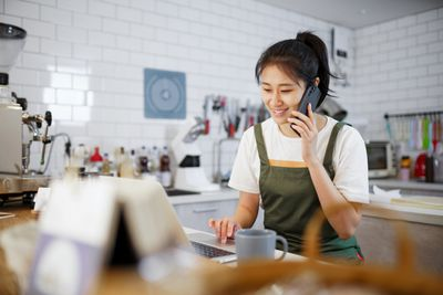 Bakery worker talking on cell phone
